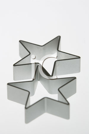 Two silver star cookie cutters.
