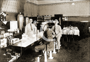 Royalty Free Photo of Men Sitting at a Counter in a Diner