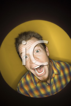 Royalty Free Photo of a Vignette of a Man on Yellow Background Laughing