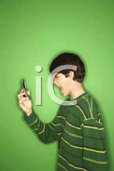 Royalty Free Photo of a Teen Boy Screaming at His Cellphone