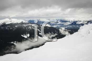 Royalty Free Photo of a Ski Resort Mountain With Snow