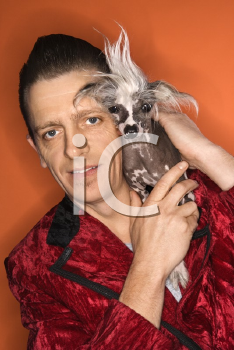 Royalty Free Photo of a Man Wearing a Velvet Jacket and Holding a Chinese Crested Dog