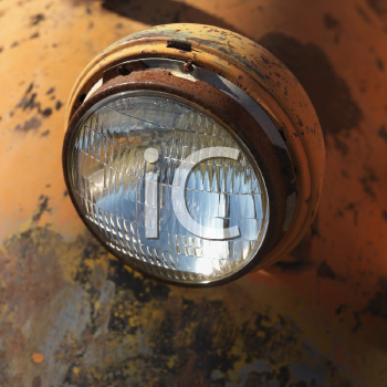Royalty Free Photo of a Headlight of a Scratched Up Rusty Old Pick-Up Truck