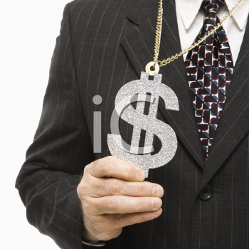 Royalty Free Photo of a Middle-Aged Businessman Wearing a Chain Necklace With an Over Sized Dollar Sign