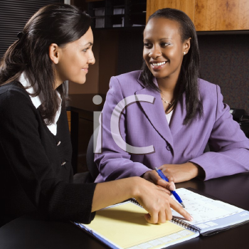 Royalty Free Photo of Businesswomen Working Together in an Office
