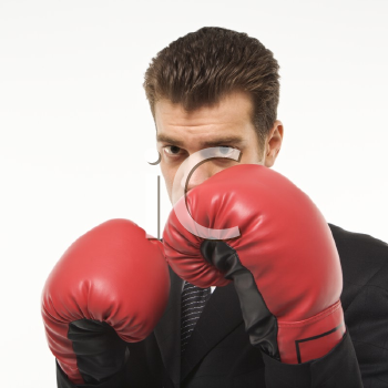 Royalty Free Photo of a Man Wearing a Suit and Boxing Gloves