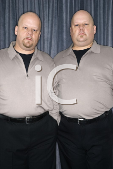 Royalty Free Photo of Identical Twin Men Standing Together