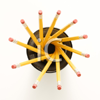 Top view of group of pencils in pencil holder arranged in a spiral shape.