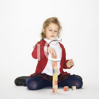 Royalty Free Photo of a Girl Playing With Toy Blocks