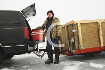 Royalty Free Photo of a Man Unloading a Cooler From a Truck in Green Lake, Minnesota, USA