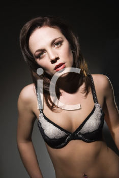 Royalty Free Photo of a Woman in Lingerie Looking at Viewer