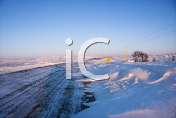 Royalty Free Photo of an Ice Covered Road and Snowy Rural Landscape