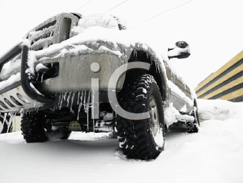 Royalty Free Photo of a SUV Covered in Snow and Ice