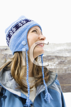 Royalty Free Photo of a Smiling Woman Wearing Blue Winter Clothing