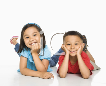 Royalty Free Photo of a Brother and Sister Lying on the Floor With Head on Hands
