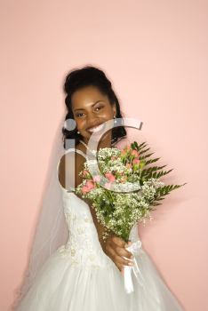 Royalty Free Photo of a Bride Holding Out a Bouquet