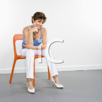 Royalty Free Photo of a Woman Sitting in a Chair