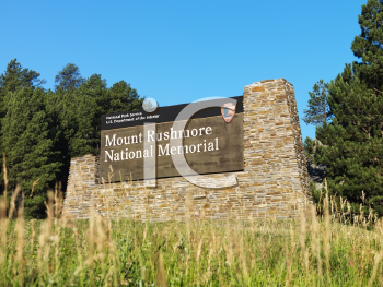 Royalty Free Photo of  a National Park Service Sign for Mount Rushmore
