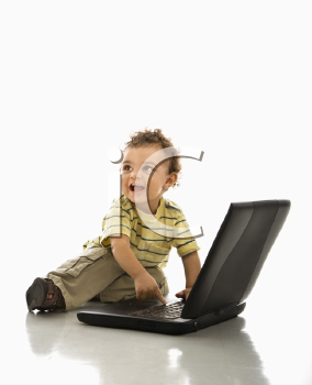 Royalty Free Photo of a Toddler Boy Playing With a Laptop