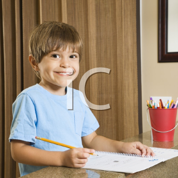 Royalty Free Photo of a Boy Doing His Homework