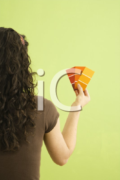 Royalty Free Photo of a Woman Holding Paint Swatches