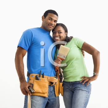 Royalty Free Photo of a Smiling Couple With Home Repair Tools