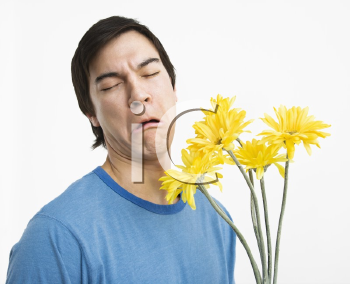 Royalty Free Photo of a Man Holding a Bouquet of Daisies