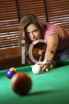 Young Woman Concentrating While Playing Pool. Vertical shot.