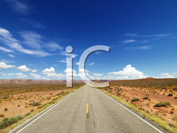 Rural State Route 261 in Utah with scenic landscape and blue sky in background. Horizontal shot.