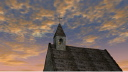 Royalty Free Video of a Cloudy Sky Over a Rotating Church With Birds Flying Overhead