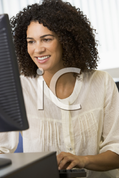 Royalty Free Photo of a Young Woman at a Computer