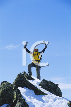 Royalty Free Photo of a Triumphant Mountain Climber