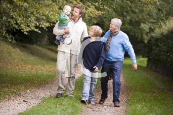 Royalty Free Photo of Three Generations of Men Walking on a Trail