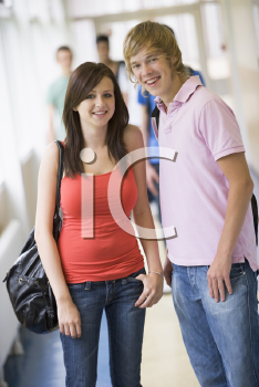 Royalty Free Photo of Two Students in a Corridor