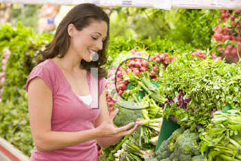 Royalty Free Photo of a Woman Shopping for Broccoli