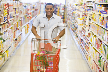Royalty Free Photo of a Man Shopping in a Grocery Store