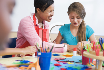 Royalty Free Photo of an Art Teacher With Students