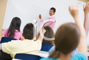 Royalty Free Photo of a Teacher at the Front of a Class