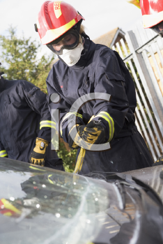 Royalty Free Photo of Firefighters Cutting a Windshield