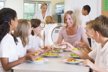 Royalty Free Photo of a Teacher at a Table With Her Students