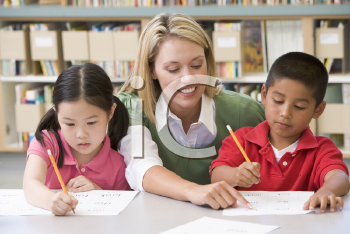 Royalty Free Photo of Two Students With a Teacher