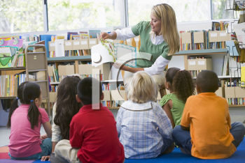 Royalty Free Photo of a Teacher Reading to Her Class