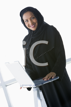 Royalty Free Photo of an Eastern Woman With a Laptop