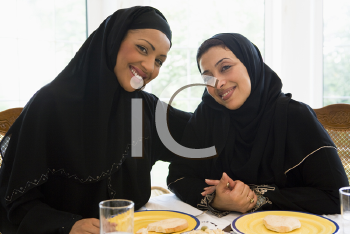 Royalty Free Photo of Two Women at a Table