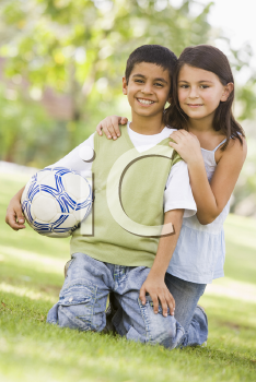 Royalty Free Photo of a Boy and Girl With a Soccer Ball