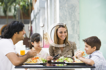 Royalty Free Photo of a Family Eating Out
