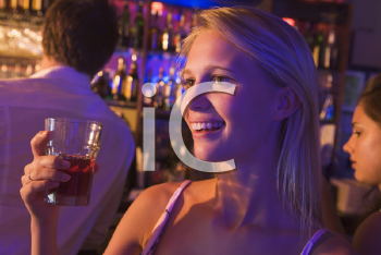 Royalty Free Photo of a Young Woman in a Bar