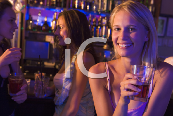 Royalty Free Photo of a Girl in a Bar With Friends