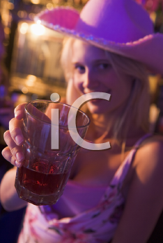 Royalty Free Photo of a Girl in a Bar