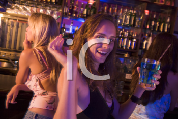 Royalty Free Photo of a Girl at a Bar With Friends